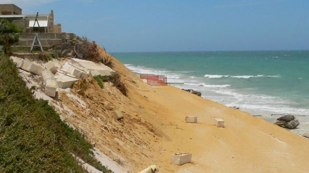 Property boundaries are crumbling in Seabird. Photo: ABC News, Bonnie Christian